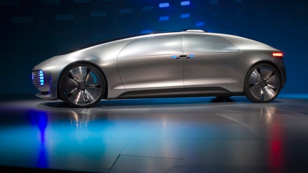 The Mercedes-Benz F015 Luxury in Motion autonomous concept car is pictured on-stage during the 2015 International Consumer Electronics Show (CES) in Las Vegas, Nevada January 5, 2015. Germany's Daimler AG wants to reset consumers' expectations about self-driving cars with its futuristic Mercedes-Benz F 015 concept, unveiled Monday evening at the annual Consumer Electronics Show in Las Vegas. REUTERS/Steve Marcus (UNITED STATES - Tags: SCIENCE TECHNOLOGY BUSINESS TRANSPORT) - RTR4K6JT