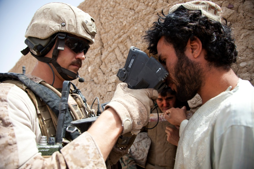 U.S. Marine Corps Capt. Bob J. Sise, left, from Wrightsville Beach, N.C., and assigned to Georgian Liaison Team-9, scans a man's retinas using a secure electronic enrollment kit during Operation Northern Lion in Mohammadabad, Helmand province, Afghanistan, June 24, 2013. Northern Lion was a Georgian-led operation conducted to deter insurgents, establish a security presence, and gather human intelligence in the area. (U.S. Marine Corps photo by Cpl. Alejandro Pena/Released)